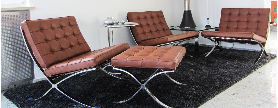 Barcelona chair cognac leather replica with with footrest by designer Mies Van der Rohe.