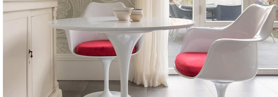 Tulip Arms Chair with tulip table designed by Eero Saarinen.