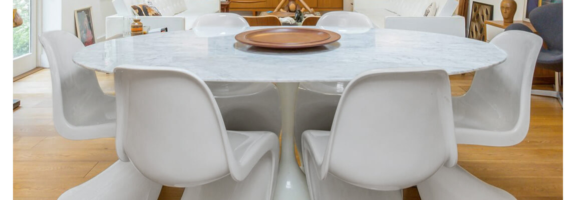 Panton Chair by designer Verner Panton with Dining Tulip Table by Eero Saarinen